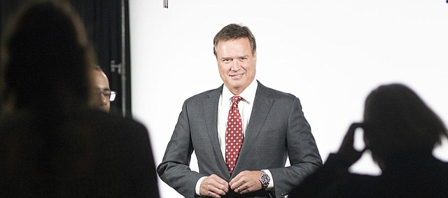 Kansas head coach Bill Self buttons up for an ESPN interview during Big 12 Media Day on Wednesday, Oct. 24, 2018 at Sprint Center.
