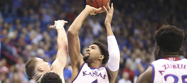 Kansas forward Dedric Lawson (1) puts up a shot against the Emporia State defense during the first half of an exhibition, Thursday, Oct. 25, 2018 at Allen Fieldhouse.