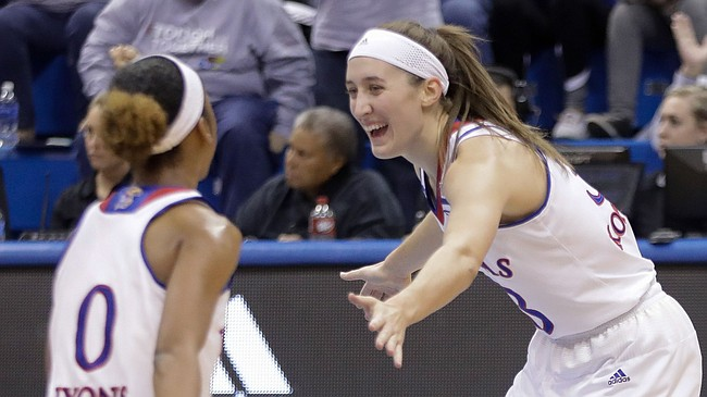 Kansas guard Kylee Kopatich (33) celebrates with a teammate after sinking one of her five first-half 3-point baskets in the Jayhawks' 66-48 win over Campbell on Sunday, Nov. 12, 2017, at Allen Fieldhouse.