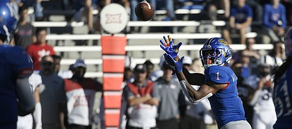 Kansas running back Pooka Williams Jr. reels in a pass from quarterback Peyton Bender Saturday.