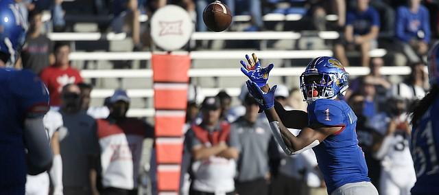 Kansas running back Pooka Williams Jr. reels in a pass from quarterback Peyton Bender Saturday.