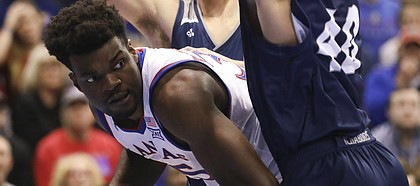 Kansas center Udoka Azubuike (35) is pressured down low by Washburn forward David Salach (40) during the first half of an exhibition, Thursday, Nov. 1, 2018, at Allen Fieldhouse.