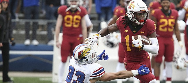 Iowa State wide receiver Tarique Milton (14) gets away from Kansas special teams player Ryan Schadler (33) during the first quarter, Saturday, Nov. 3, 2018 at Memorial Stadium.