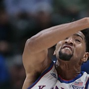 Kansas forward Dedric Lawson (1) fights for a rebound with Michigan State forward Xavier Tillman (23) during the first half of an NCAA college basketball game at the Champions Classic on Tuesday, Nov. 6, 2018, in Indianapolis.