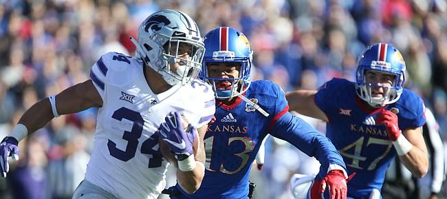 Kansas cornerback Hasan Defense (13) chases down Kansas State running back Alex Barnes (34) during the second quarter on Saturday, Oct. 28, 2017 at Memorial Stadium.