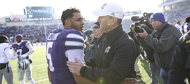 Kansas State quarterback Alex Delton (5) gives a hug to Kansas head coach David Beaty following the Jayhawks' 21-17 loss to the Wildcats on Saturday, Nov. 10, 2018 at Bill Snyder Family Stadium in Manhattan, Kan.