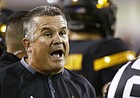 FILE - In this Oct. 14, 2017, file photo, Arizona State coach Todd Graham, left, argues with an official during the first half of an NCAA college football game against Washington in Tempe, Ariz. Arizona State fired Graham on Sunday, Nov. 26, after six seasons with the Sun Devils that earned five bowl trips. (AP Photo/Ross D. Franklin, File)