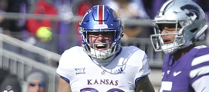 Kansas linebacker Joe Dineen Jr. (29) celebrates a stop before Kansas State quarterback Alex Delton (5) during the second quarter on Saturday, Nov. 10, 2018 at Bill Snyder Family Stadium in Manhattan, Kan.