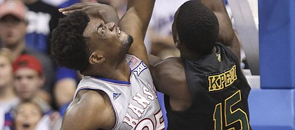 Kansas center Udoka Azubuike (35) gets physical with Vermont forward Ra Kpedi (15) during the first half, Monday, Nov. 12, 2018 at Allen Fieldhouse.