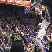 Kansas center Udoka Azubuike (35) delivers a dunk before the Vermont defense during the first half, Monday, Nov. 12, 2018 at Allen Fieldhouse.