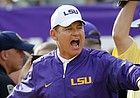 FILE — LSU head coach Les Miles calls pout to his team during warmups before an NCAA college football game against Mississippi State in Baton Rouge, La., Saturday, Sept. 17, 2016. (AP Photo/Gerald Herbert)