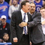 Kansas head coach Bill Self is held back by assistant Kurtis Townsend as he yells at an official while disputing a call during the first half, Friday, Nov. 16, 2018 at Allen Fieldhouse.