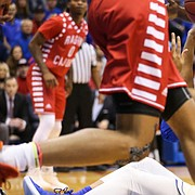 Kansas forward Dedric Lawson (1) puts up a shot and connects while seated on the floor during the first half, Friday, Nov. 16, 2018 at Allen Fieldhouse.