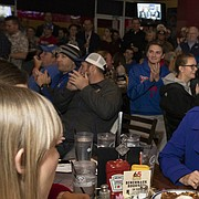 """Newly-hired Kansas head football coach Les Miles sits next to his wife, Kathy, as they listen to Kansas Athletic Director Jeff Long tell a story about hiring Miles during the """"Hawk Talk"""" radio show on Sunday, Nov. 18, 2018, at Johnny's West in Lawrence. Miles was announced as the head coach earlier in the day."""
