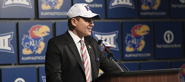 University of Kansas football coach Les Miles smiles as he addresses the media Sunday, Nov. 18, 2018, at Hadl Auditorium.