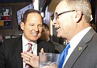 """Newly-hired Kansas football coach Les Miles, left, and Kansas Athletic Director Jeff Long talk during the """"Hawk Talk"""" radio show on Sunday, Nov. 18, 2018, at Johnny's West in Lawrence."""