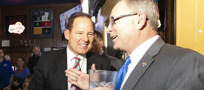 "Newly-hired Kansas football coach Les Miles, left, and Kansas Athletic Director Jeff Long talk during the ""Hawk Talk"" radio show on Sunday, Nov. 18, 2018, at Johnny's West in Lawrence."