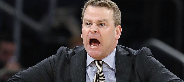 Marquette coach Steve Wojciechowski gestures toward a referee during the second half of the team's NCAA college basketball game against DePaul in the first round of the Big East men's tournament in New York, Wednesday, March 7, 2018.