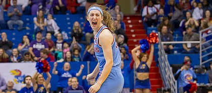 Kansas guard Kylee Kopatich (33) lets out a scream after making a 3-pointer late in the fourth quarter Sunday against Kansas State at Allen Fieldhouse.