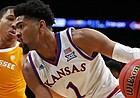 Kansas forward Dedric Lawson (1) drives to the basket past Tennessee forward Grant Williams (2) during the first half of an NCAA college basketball game in the NIT Season Tip-Off tournament Friday, Nov. 23, 2018, in New York. (AP Photo/Adam Hunger)