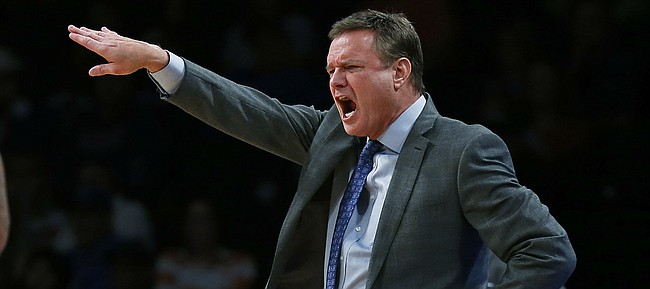 Kansas coach Bill Self gestures to his team during the second half of an NCAA college basketball game against Tennessee in the NIT Season Tip-Off tournament Friday, Nov. 23, 2018, in New York. Kansas defeated Tennessee 87-81 in overtime. (AP Photo/Adam Hunger)