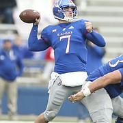 Kansas quarterback Peyton Bender (7) has blockers as he throws deep during the second quarter on Friday, Nov. 23, 2018 at Memorial Stadium.