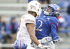 Kansas cornerback Corione Harris (2) knocks away a ball intended for Texas quarterback Casey Thompson (8) during the second quarter on Friday, Nov. 23, 2018 at Memorial Stadium. Also pictured is Kansas safety Mike Lee (11).