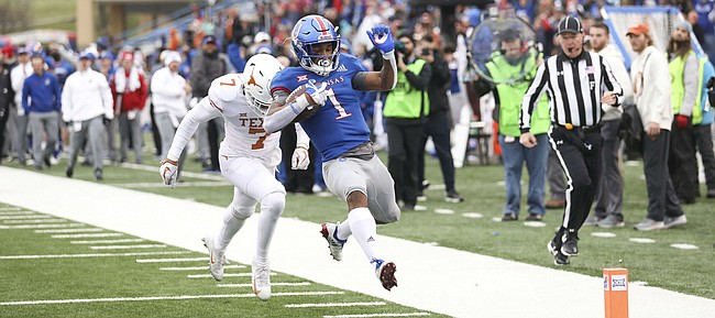 Kansas running back Pooka Williams Jr. (1) leaves Texas defensive back Caden Sterns (7) behind as he skips into the end zone for a touchdown during the fourth quarter on Friday, Nov. 23, 2018 at Memorial Stadium.