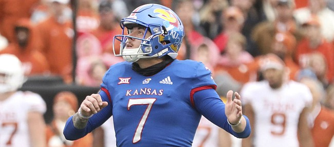 Kansas place kicker Gabriel Rui (7) watches his final field goal sail through the uprights during the fourth quarter on Friday, Nov. 23, 2018 at Memorial Stadium.