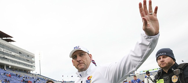 Outgoing Kansas head coach David Beaty waves goodbye to a gathering of fans as he leaves Memorial Stadium for a the final time as head coach following The Jayhawks' 24-17 loss to Texas on Friday, Nov. 23, 2018 at Memorial Stadium.