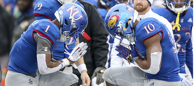 Kansas running back Pooka Williams Jr. (1) and Kansas running back Khalil Herbert (10) celebrate a touchdown by Williams by bowing to each other during the fourth quarter on Friday, Nov. 23, 2018 at Memorial Stadium.