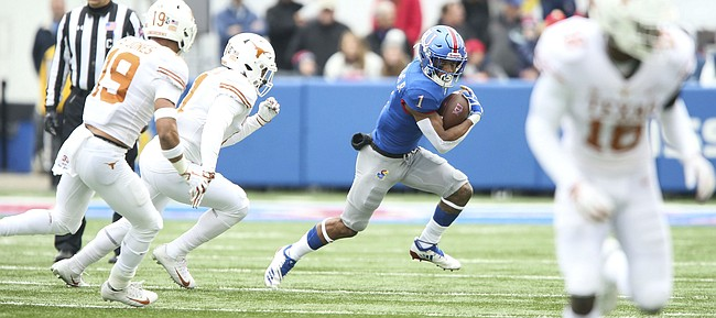 Kansas running back Pooka Williams Jr. (1) takes off on a run during the first quarter on Friday, Nov. 23, 2018 at Memorial Stadium.