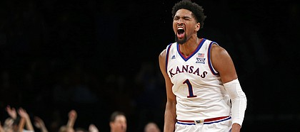 Kansas forward Dedric Lawson reacts after scoring a basket during overtime of the team's NCAA college basketball game against Tennessee in the NIT Season Tip-Off tournament Friday, Nov. 23, 2018, in New York. Kansas defeated Tennessee 87-81. (AP Photo/Adam Hunger)