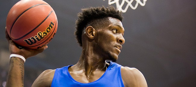 Sophomore forward Silvio De Sousa inbounds the ball at Late Night in the Phog on Friday, Sept. 28, 2018 at Allen Fieldhouse.