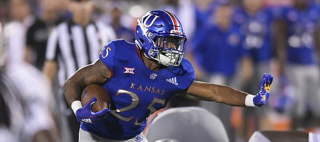 Kansas running back Dom Williams (25) runs against Nicholls State during the second half of an NCAA college football game in Lawrence, Kan., Saturday, Sept. 1, 2018. (AP Photo/Reed Hoffmann)