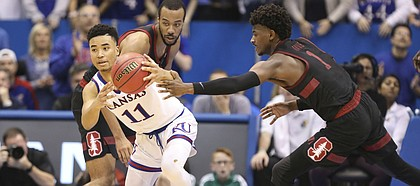 Kansas guard Devon Dotson (11) gets a steal from Stanford guard Daejon Davis (1) during the second half on Saturday, Dec. 1, 2018 at Allen Fieldhouse.
