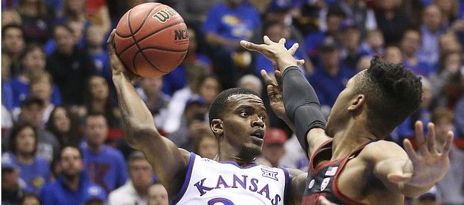 Kansas guard Lagerald Vick (24) looks for an outlet while defended by Stanford forward KZ Okpala (0) during the first half on Saturday, Dec. 1, 2018 at Allen Fieldhouse.
