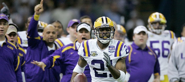 FILE — LSU cornerback Chevis Jackson (21) returns the ball 31-yards after intercepting an Ohio State pass in the second quarter during the BCS championship college football game at the Louisiana Superdome in New Orleans, Monday, Jan. 7, 2008. Jackson became the first assistant coach hired by Miles at Kansas on Dec. 2, 2018, when Miles named Jackson the team's defensive backs coach. (AP Photo/Charlie Riedel)
