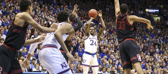Kansas guard Lagerald Vick (24) spots up for a three during the second half on Saturday, Dec. 1, 2018 at Allen Fieldhouse.