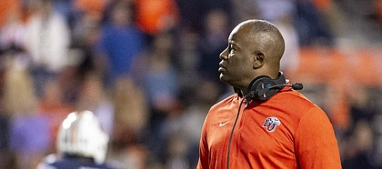 FILE — Liberty head coach Turner Gill looks on during an injury break in the second half of an NCAA college football game against Auburn, Saturday, Nov. 17, 2018, in Auburn, Ala. (AP Photo/Vasha Hunt)