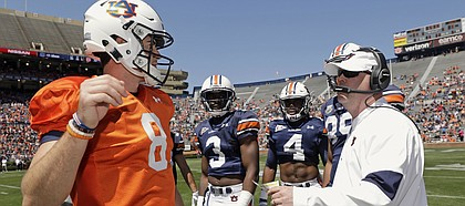 FILE — Auburn quarterback Jarrett Stidham with offensive coordinator Chip Lindsey in the second half of Auburn A-Day NCAA college football game on Saturday, April 8, 2017 in Auburn, Ala. (AP Photo/Todd J. Van Emst)