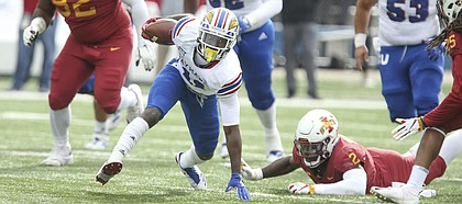 Kansas wide receiver Steven Sims Jr. (11) tries to regain his footing as the Iowa State defense closes in during the first quarter, Saturday, Nov. 3, 2018 at Memorial Stadium.