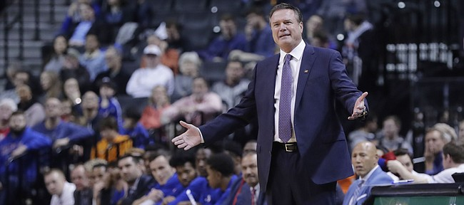 Kansas coach Bill Self gestures during the first half of the team's NCAA college basketball game against Marquette in the NIT Season Tip-Off tournament Wednesday, Nov. 21, 2018, in New York. (AP Photo/Frank Franklin II)