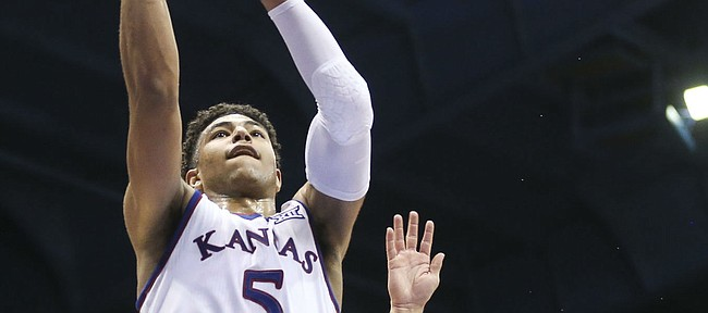 Kansas guard Quentin Grimes (5) soars in for a bucket past Wofford guard Nathan Hoover (10) during the second half on Tuesday, Dec. 4, 2018 at Allen Fieldhouse.
