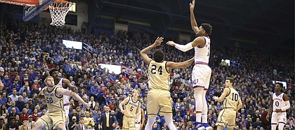 Kansas forward Dedric Lawson (1) turns for a shot over Wofford forward Keve Aluma (24) during the first half on Tuesday, Dec. 4, 2018 at Allen Fieldhouse.