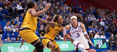 KU senior Jessica Washington (3) makes a move past Grambling State Kendriana Washington (20) in the second quarter Sunday afternoon in Allen Fieldhouse.