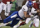 Kansas linebacker Joe Dineen Jr. (29) tackles Oklahoma quarterback Kyler Murray (1) during the first half of an NCAA college football game in Norman, Okla., Saturday, Nov. 17, 2018. (AP Photo/Alonzo Adams)