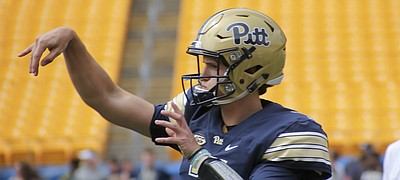 FILE — Former Pittsburgh quarterback Thomas MacVittie (7) warms up before the annual Pittsburgh Spring NCAA football scrimmage, Saturday, April 15, 2017, in Pittsburgh. MacVittie, who played the 2018 season at Mesa Community College (Ariz.) announced on Dec. 11, 2018, his plans to sign with the University of Kansas. (AP Photo/Keith Srakocic)