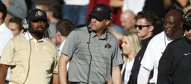 FILE — Former Colorado Buffaloes defensive coordinator D.J. Eliot, center, in the first half of an NCAA college football game Saturday, Nov. 11, 2017, in Boulder, Colo. Eliot agreed in December of 2018 to join the Kansas football program as the defensive coordinator for Les Miles. (AP Photo/David Zalubowski)