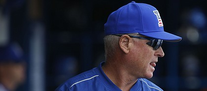 Kansas head coach Ritch Price paces the dugout during the second inning on Tuesday, Feb. 28, 2017.